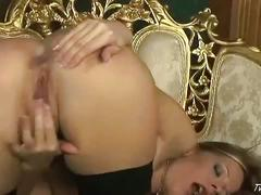 Hot blonde in stocking fingers her pussy