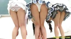 3 asian schoolgirls showing off their panties