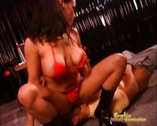 Mistress dressed in red leather sits on slaves face