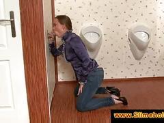 Classy girl eats cum through a gloryhole