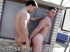 Two cute young guys fuck behind a power meter in public