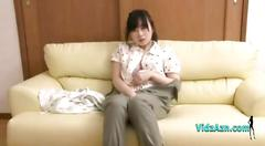 Asian girl watching porn and masturbating with a vibrator