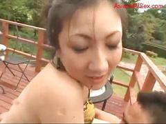 Milf in bikini fucking with guy on the balcony in...