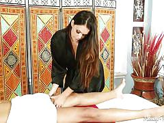 Masseuse strips and sucks cock
