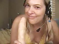 Begging for tips while gagging on a dildo