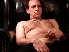 Hairy daddy jerks his hard cock on couch