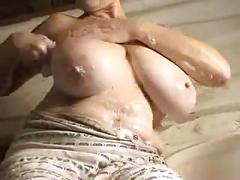 Washing big natural tits