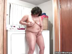 Lactating granny drinks her milk and masturbates