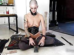 Abigail makes herself a new collar for her bdsm games
