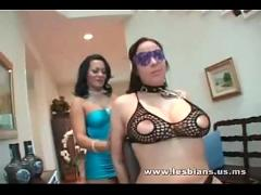 Lesbian whipping another lesbian with big tits