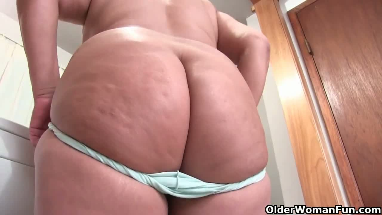 Lactating granny drinks her milk and masturbates