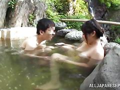 Chubby chick gets her nipples licked in the onsen