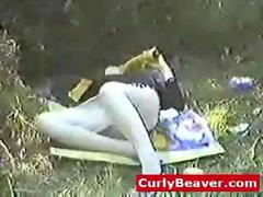 Amateur girl with hairy pussy playing with huge dildos outdoor