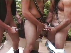 Lewd muscled fuckers in leather ramming some holes in threesome