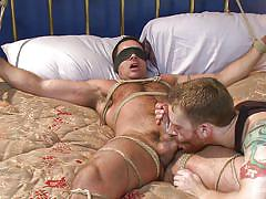 Gay hunk is tied up and jacked off