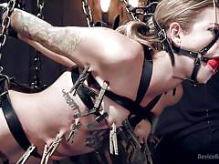 Gagged slut is hanged from the ceiling