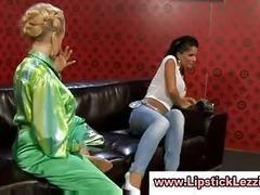 Clothed european lesbos babes get soaked and strip