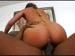 Plugging her ass with a big black cock