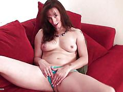 Mature plays with her vagina