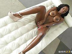 Ebony babe gets some oil on her big boobs