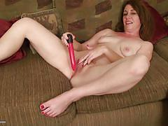 Mature has some fun with a dildo