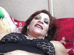 Mature woman sucks big black cock