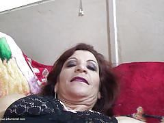 Mature woman sucks big black cock