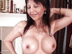 Mature with big boobs undressing