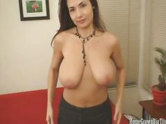 Tara pleasures a cock with her huge tits