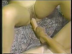 Lesbians with big tits lick each other's pussies in bed