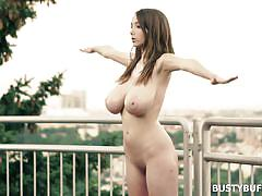 Busty buffy meditating and stretching naked