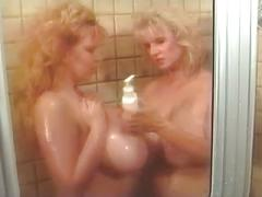 Big tits need four hands in the shower.