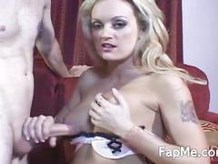 Busty blonde jerks off a hard cock