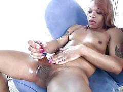 Black tranny has something under her panties