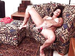 Mature slut plays with her dildo