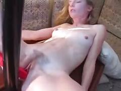 Woman fucks a pole