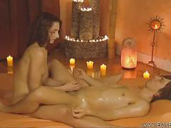 Lovely brunette gives nice oily handjob
