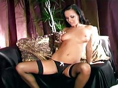 Teasing brunette with stiletto high heels a teddy panties and stockings