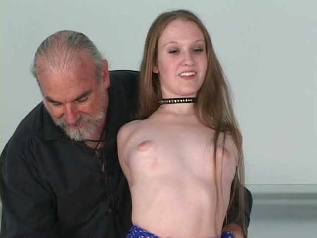 Young brunette is restrained and roped up to a sybian style sex machine