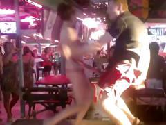 Russian girl striptease in thai bar outdoor