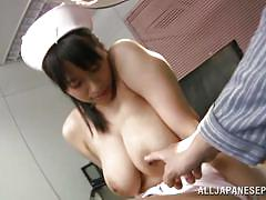 Japanese nurse has huge natural tits