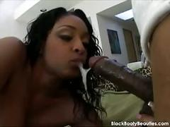 Black cock disappears inside a black pussy