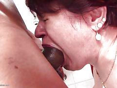Mature goes to toilet, ends up with a cock in her mouth