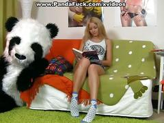 Sexy girl having fun with her panda bear