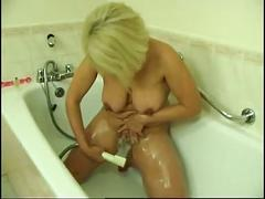 She uses a shower head to make her cum