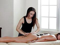 Sexy babe gets a hot stone massage from her lesbian lover