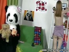 Cute teen dresses up her toypanda for shots