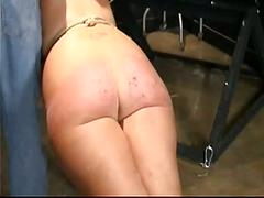 Husband caning wife with homemade cane