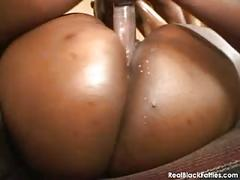 A massive black babe is oiled up and fucked