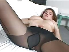 Busty brunette milf teases in black pantyhose